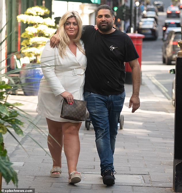 Sizzling: Gemma Collins, 40, wowed in a cream belted playsuit as she headed out for a boozy brunch with a male pal in London on Saturday