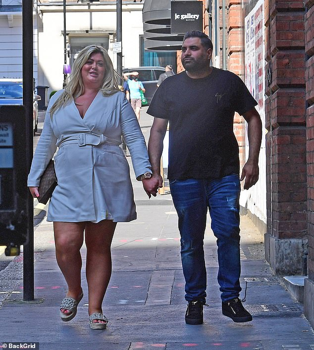 New man? The pair were pictured leaving the venue later on Saturday evening, holding hands with eachother