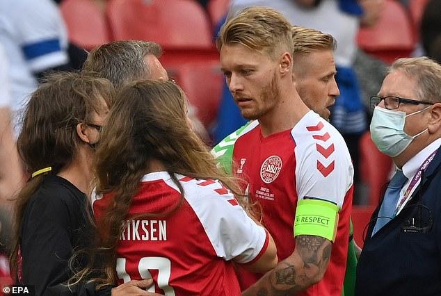 Denmark captain Simon Kjaer (right) stood up as a leader when Christian Eriksen collapsed