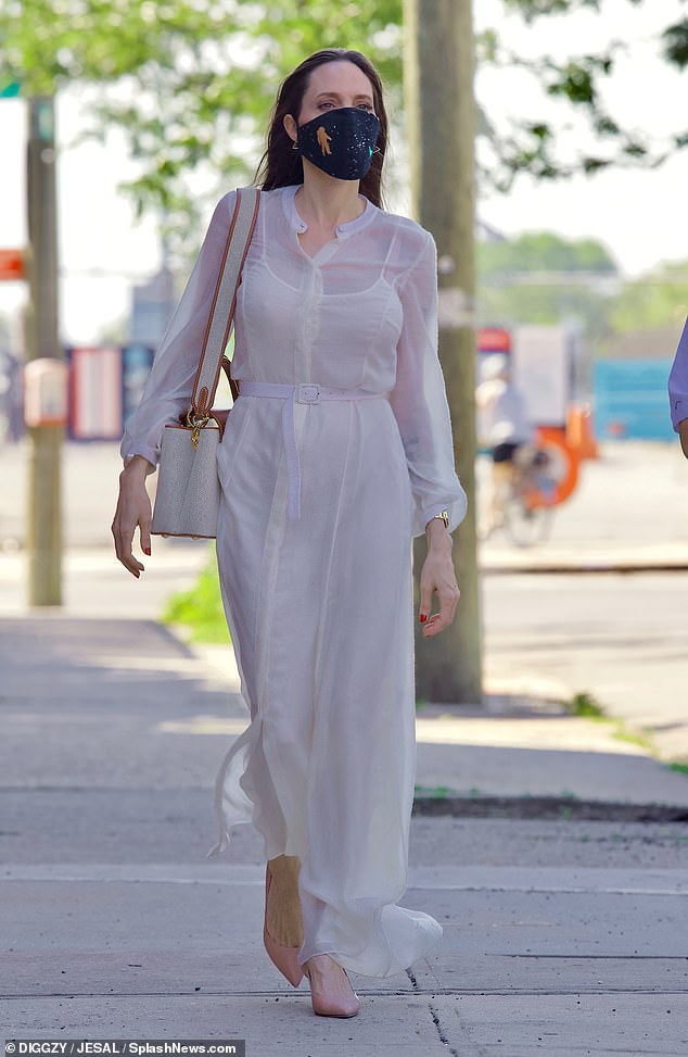 Ethereal: The Oscar-winning actress wore a long white kaftan-style shirtdress with balloon sleeves over white spaghetti strap briefs