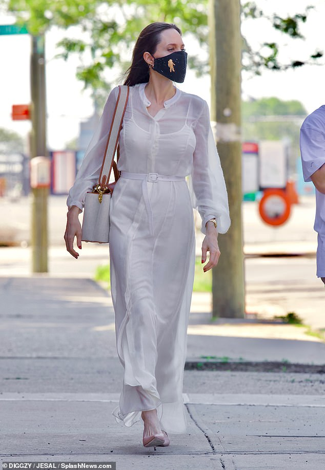 Former Flame: And Jolie's day in the borough also included a visit to her ex-husband Jonny Lee Miller's Dumbo apartment later that night