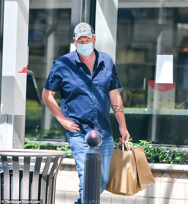 Groom to be:Blake Shelton was seen on his own on Saturday, on a solo grocery run to Gelson's in Encino