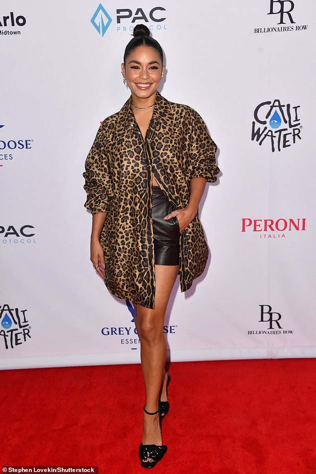 Beauty: Vanessa Hudgens showed off her wild side in a long leopard blouse, which she mostly kept unbuttoned to showcase her toned abs at the premiere of her new movie Asking For It