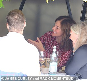 Centre of attention: All eyes were on Trinny during the meal