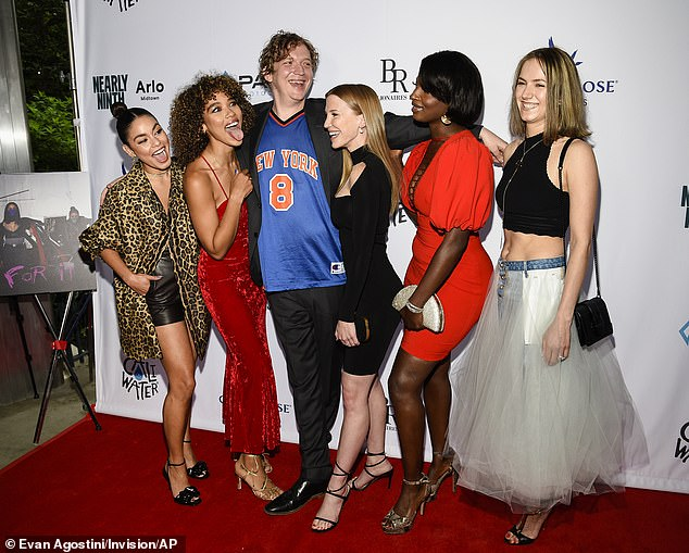 Friendly Cast: Director Eamon O'Rourke, center, poses with Hudgens, Shipp, Leslie Stratton, Lisa Yaro and Katerina Baker pose together during a special screening of Asking For It at the SVA Theater