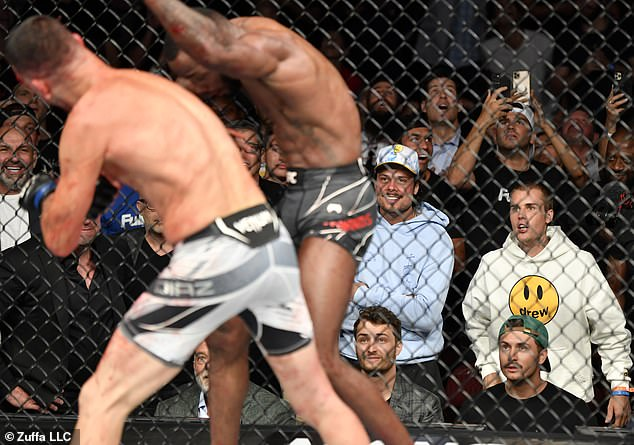 Take that! The Canadian pals watched during the welterweight fight between Nate Diaz and Leon Edwards of Jamaica, which Leon ultimately won