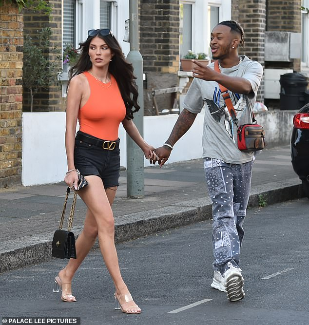 Couple:Biggs wore a grey tee and patterned joggers with box fresh trainers for his outing