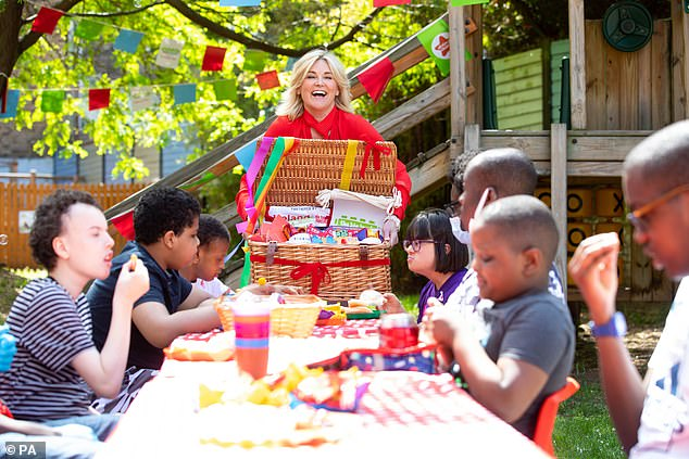 Go for it:The television presenter, 61, served a meal at Action for Children in London as part of the Big Lunch initiative