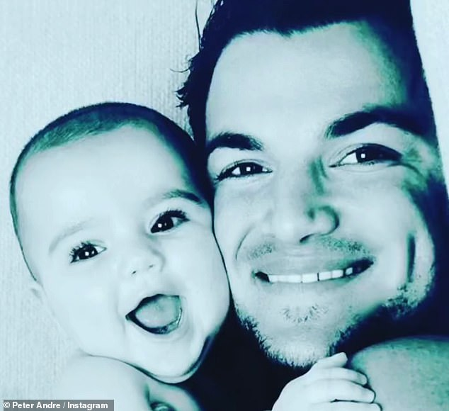 Sweet: Peter started his post with an adorable black-and-white snap of himself cuddled up to his son when he was just a baby