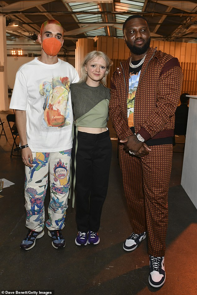 Fashion mogul: Reuben donned a pair of striking patterned trousers which were emblazoned with images from the cartoon Rick & Morty and also wore trainers for the occasion