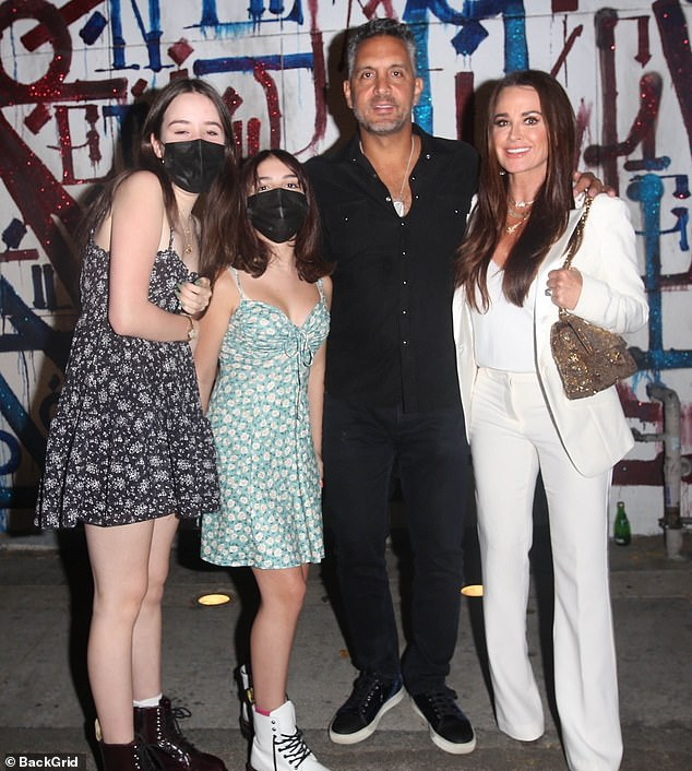 Family outing: The family of reality tv fame was seen posing for a group snap outside of the celebrity haunt