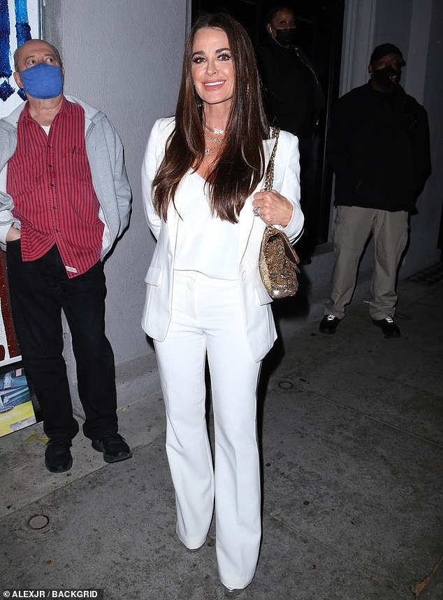 Smiling big: Kyle Richards, 52, looks radiant in all white as she enjoys dinner at Craig's with her husband Mauricio Umansky and their youngest daughter Portia, 13