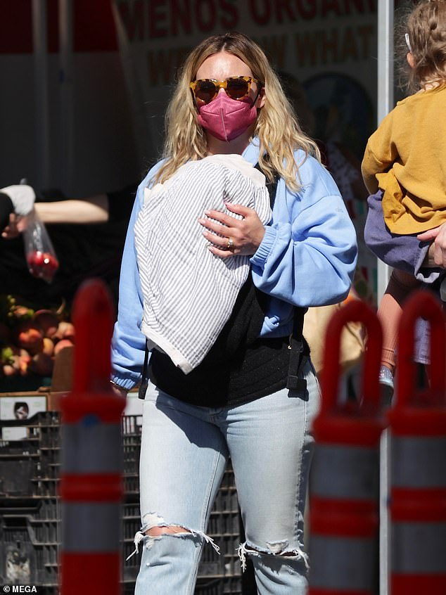 Doting mom: Meanwhile, outside of her acting career, Duff is also a doting mom of three