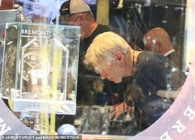 Still got it: The actor looked in incredible shape with bulging biceps and pecs were visible through his navy blue T-shirt at the shop in London