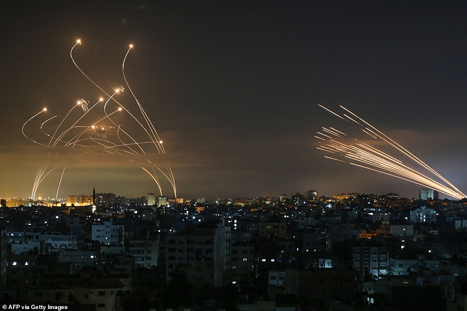 Rockets seen in the night sky fired towards Israel from Beit Lahia in the northern Gaza Strip on May 14, 2021