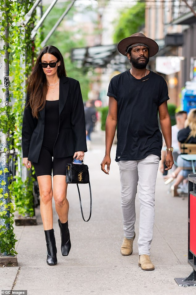 Stylish couple:Nicole Trunfio, 35, (left) and her musician husband Gary Clark Jr., 37, (right) looked effortlessly chic as they arrived at their trendy hotel in New York together