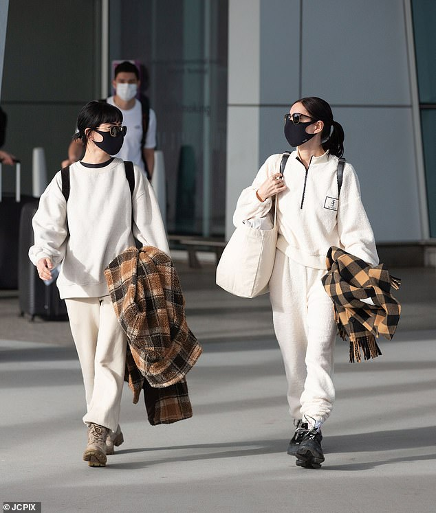 Matching! The Hook Me Up singers wore near identical sweaters, trousers and styled their look with matching face masks and sunglasses