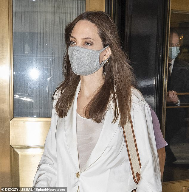 Safety first!  At all times, Angelina wore a gray face mask to protect herself and others from the coronavirus as she left her hotel for sightseeing and shopping