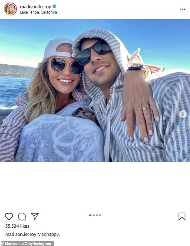 Loved up: She did not name the new love interest but she did indicate how she feels about the relationship as she captioned the snap to her 510K followers: 'Madhappy'