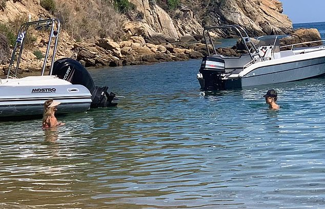 Secluded spot: The Hollywood A-listers arrived on a boat at a remote beach on the stunning island of Skiathos, catching a handful of tourists who were also there, by surprise