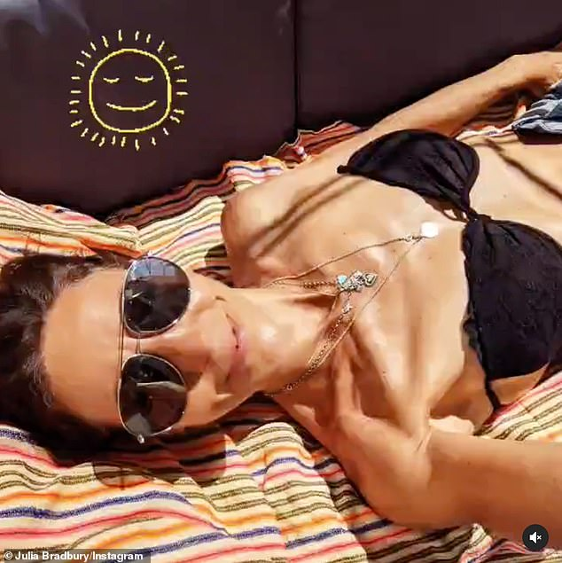 Flawless: Julia Bradbury embraced the UK sunshine on Saturday as she took to Instagram to showcase her slender figure in a plunging black bikini amidst the heat wave