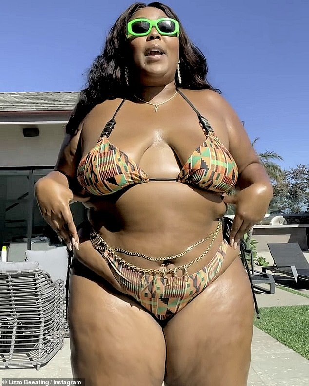 Ready to rock:The Truth Hurts singer was seen in an earth toned bikini that made the most of her curves as she added a gold belly chain that said LIZZO on front