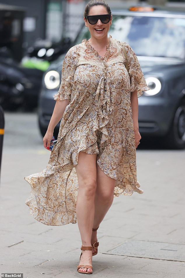 Beautiful: Kelly Brook, 41, looked radiant on Monday as she arrived to host her Heart FM drive time show at Global Studios in London
