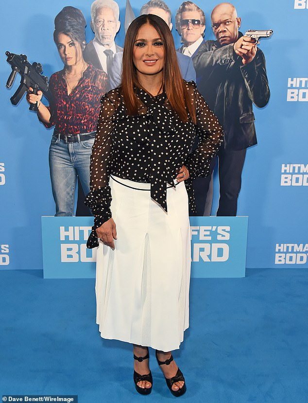 Stylish: Salma Hayek looked effortlessly chic as she stepped out in a polka dot blouse at the premiere of her latest film, the Hitman's Wife's Bodyguard, at Cineworld on Monday night