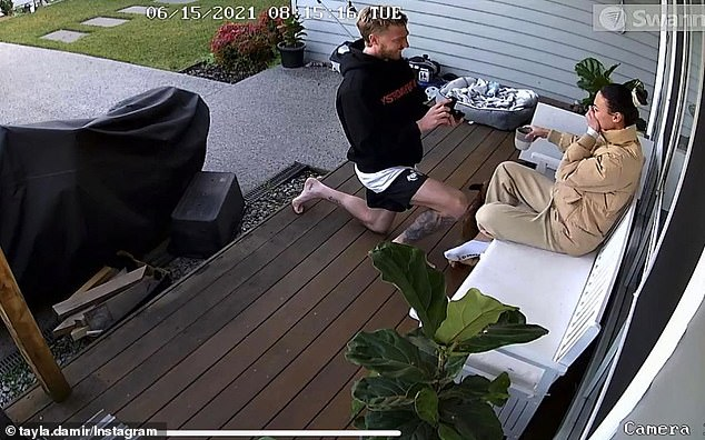 Sweet: Tayla also shared a video of the moment Nathan offered on their porch, which was recorded on their home CCTV system.