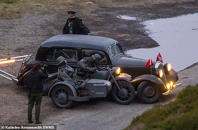 Flashback: Indiana Jones 5 castmembers were seen filming flashback scenes dressed as Nazis on Monday... 40 years after Harrison Ford took on the soldiers in Raiders of the Lost Ark