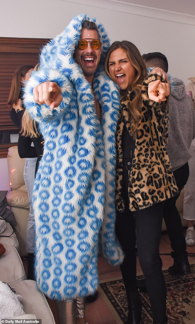 At one point, Pascal was seen posing for a photo with a caramel-haired beauty wearing a cheetah print coat