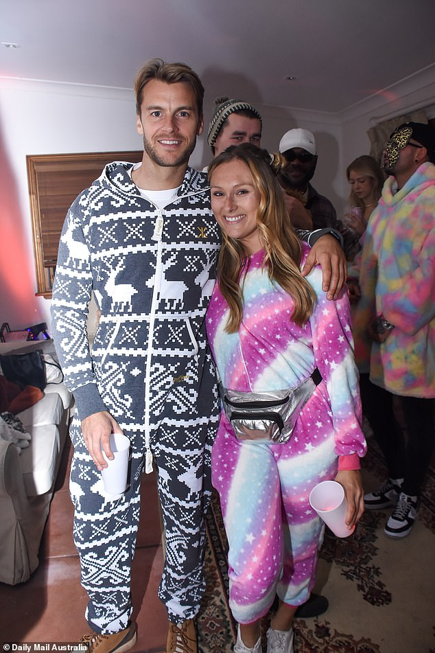 Who knew they were friends?  Former professional tennis player Miles Bugby and his company Jennifer Sampson were in costume for the occasion
