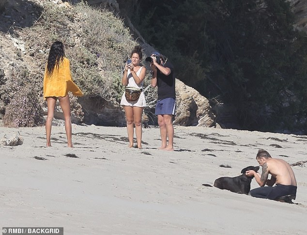 Action!  As Kinnaman hugged his canine companion, Gale worked hard with photographer Cameron Hammond (2-R) for the shoot