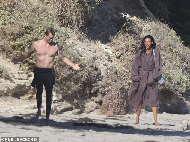 Always so strong!  Kelly - who then covered herself in a bathrobe - has been dating Joel since Valentine's Day 2019