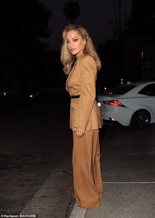 Looking good:The singer, 30, ensured all eyes were on her as she donned a beige retro-inspired blazer with a matching pair of trousers