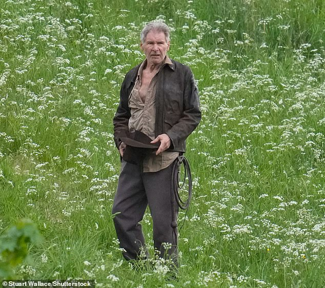 Back at it: Harrison, 78, is reprising his role as Indiana Jones 30 years after the film franchise began and 13 years on from the last film,Kingdom of the Crystal Skull (pictured on set)