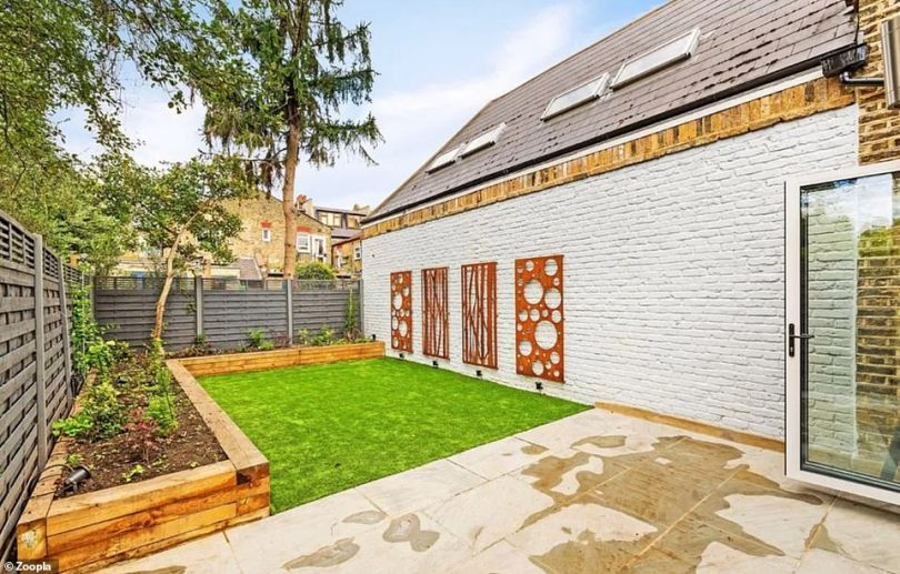 Outdoor space:A rarity for a London property, the home also has space for a beautifully appointed and landscaped 24 foot garden complete with retro sculptures on the walls