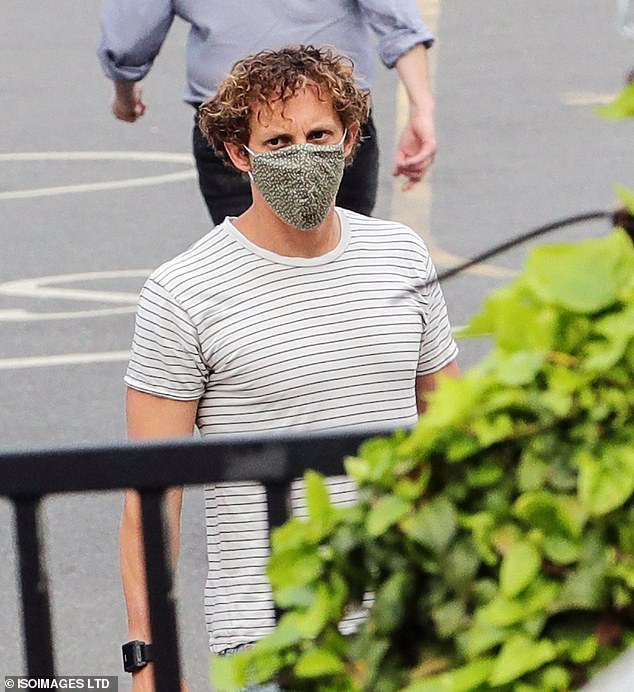 Precautions: Paul made sure to put safety first and donned a face mask when stepping out on Wednesday
