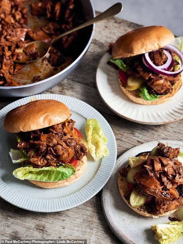 These juicy pulled jackfruit burgers are best served with lettuce on the base of a burger bun and vegan cheese