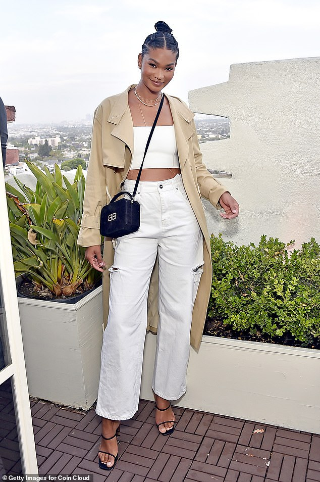 On top of the harvests!  Chanel Iman flashed her toned abs in a white cropped top with matching jeans