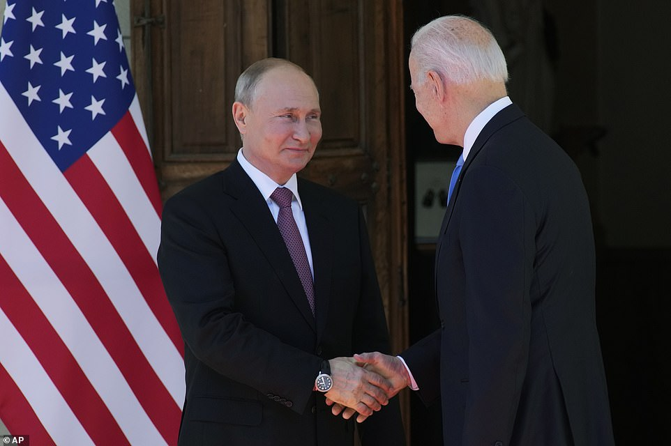 Biden extended his hand first. Putin accepted, and the two proceeded to shake hands and smile for the cameras.They ignored questions shouted by reporters covering the summit.