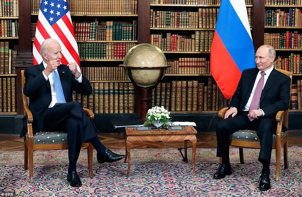 Putin smiles thoughtfully as Biden gestures with his fists as the pair start their summit in Geneva