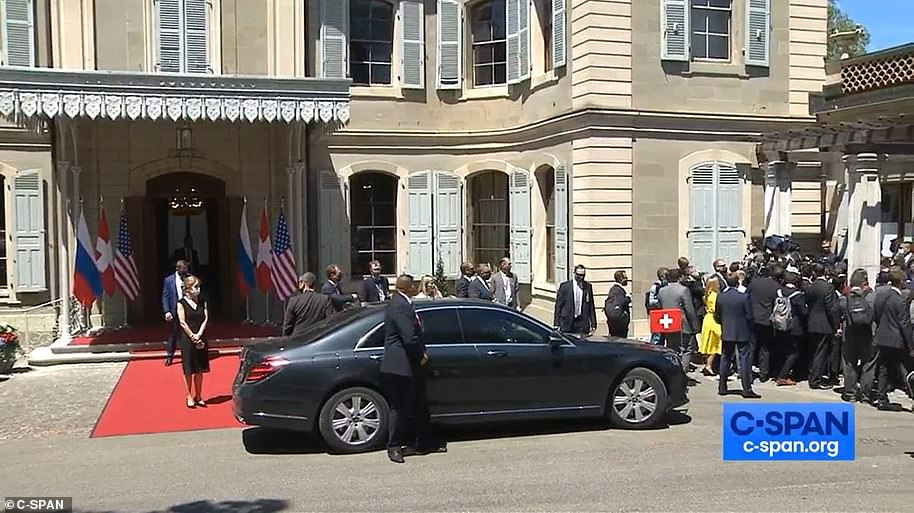 Members of the media scramble to get into the villa where Biden and Putin were meeting