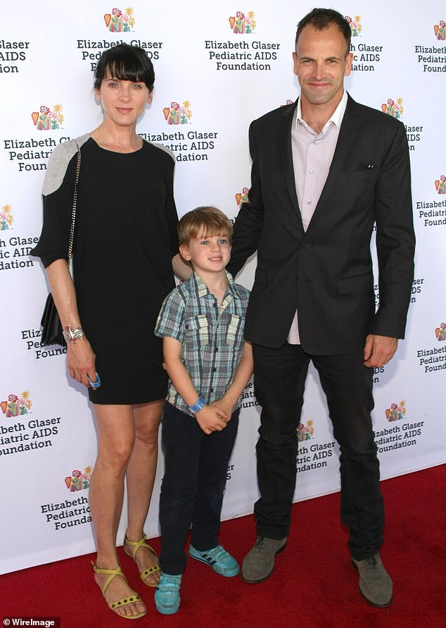 The way they were: Hicks, Miller and son Buster attend Elizabeth Glaser Pediatric AIDS Foundation's Family Festival in 2014 in New York City