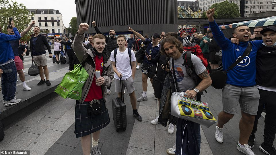 Mr Khan said: 'Scottish fans are renowned around the world for bringing a party atmosphere with them to the big tournaments but with COVID restrictions still in place on both sides of the border, the best thing for fans without tickets to the game or a safe place to watch it is to enjoy the game from Scotland and not come'. Pictured: Fans in London yesterday