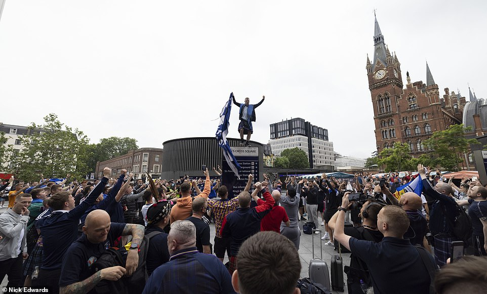 It is thought that Scotland will join England in taking a knee to protest racial inequality during Friday's game. Pictured: Scotland fans at King's Cross Station yesterday