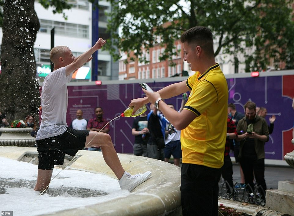 Football fans in Leicester Square pouring washing up liquid into the William Shakespeare fountain last night