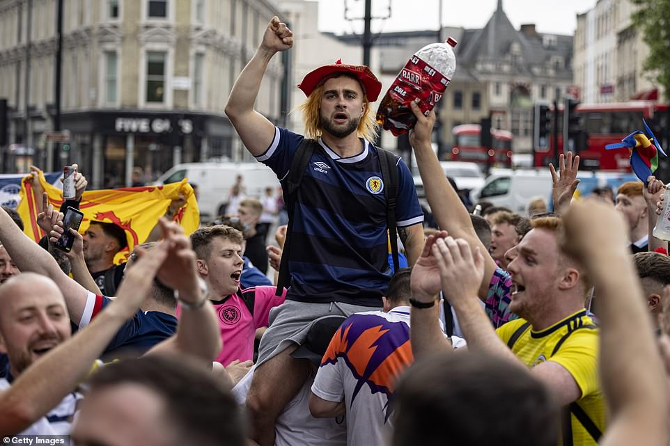 Scotland fans chanting outside King's Cross Station on June 17, 2021 in London as the outlawed festivities got going