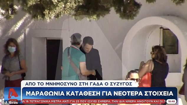 TV footage taken at Caroline's memorial service on Wednesday shows Babis speaking with mourners moments before being led away by police