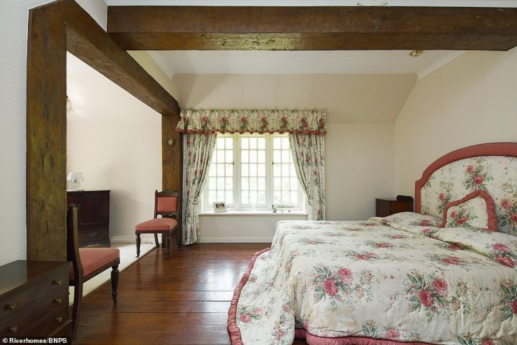 Ms Stickney added:'Marlow is very popular, the great and the good of the entertainment world have all flocked there, particularly during lockdown, looking for outdoor space and places to walk. The DJ Chris Evans lives there - he calls it Marlow-fornia - and chef Tom Kerridge.' Pictured: One of the two upstairs bedrooms with exposed beams and wooden flooring